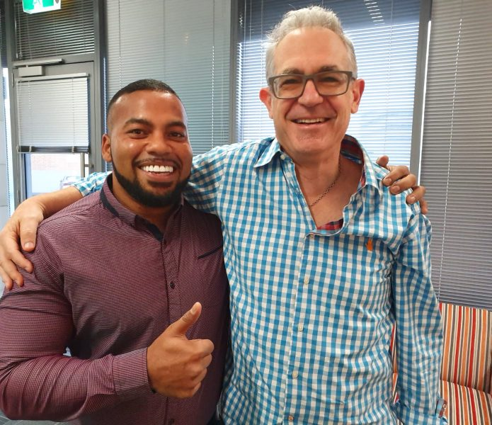 Dr Sean Slotar smiling with a happy client